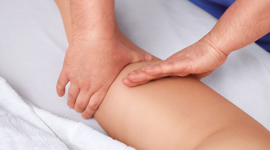 The masseur makes Anti-cellulite massage on the buttock and thighs of the patient